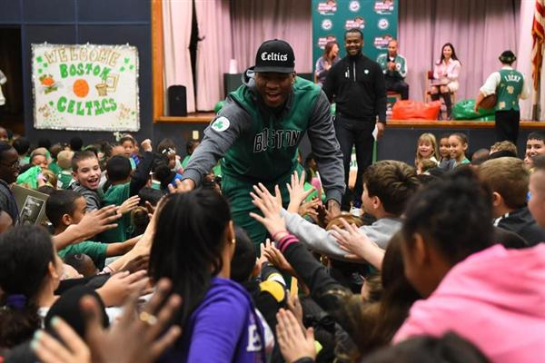 Excited students greet Celtics player Marcus Smart, who visited the Roosevelt as part of their Read to Achieve program.  Students earned the visit by reading the most nights of participating schools.  Way to go Roosevelt readers!