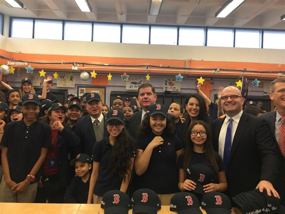 Superintendent Tommy Chang and Mayor Marty Walsh pose with students with their new Red Sox hats