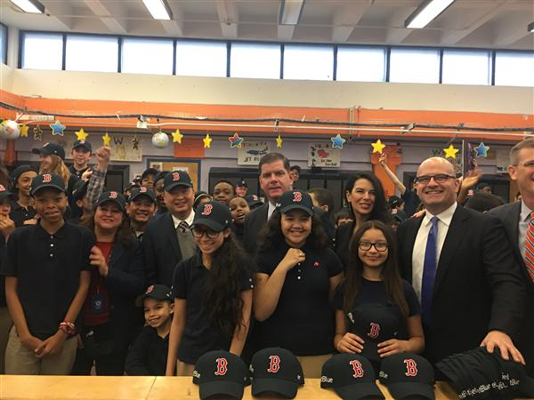 Mayor Marty Walsh and Superintendent Tommy Chang pose with students wearing Red Sox hats