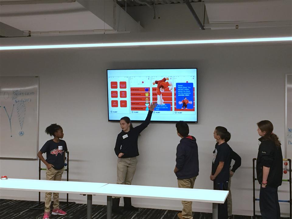 Perry K-8 School pitch their app ideas to a panel of judges.
