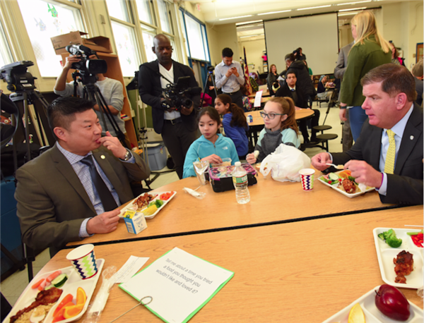 Walsh and Chang eat lunch with students at the Bradley School on April 2, 2018
