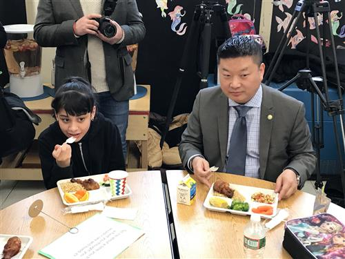 Chang eats with a student at the Bradley School on 4/2/18