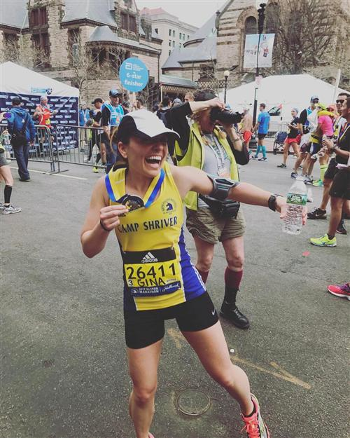 Gina D'Addario with her medal after running the 2017 Boston Marathon