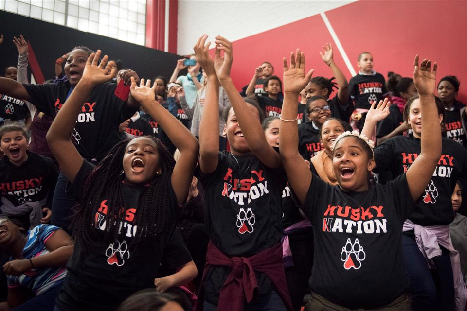 "BPS students cheer while wearing ""Husky Nation"" t-shirts"