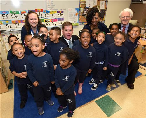 Photo - Mayor Walsh poses for a photo with a class of students from Mission Hill Grammar School