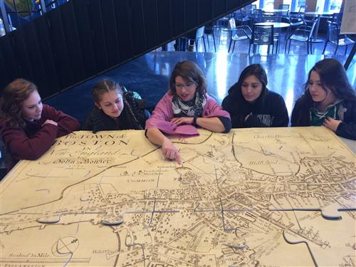 Michelle LeBlanc of the Leventhal Map Center showing students a map of historic Boston.