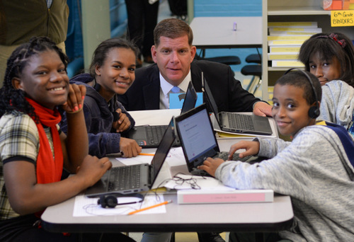 Mayor Marty Walsh sits with students from TechBoston Academy