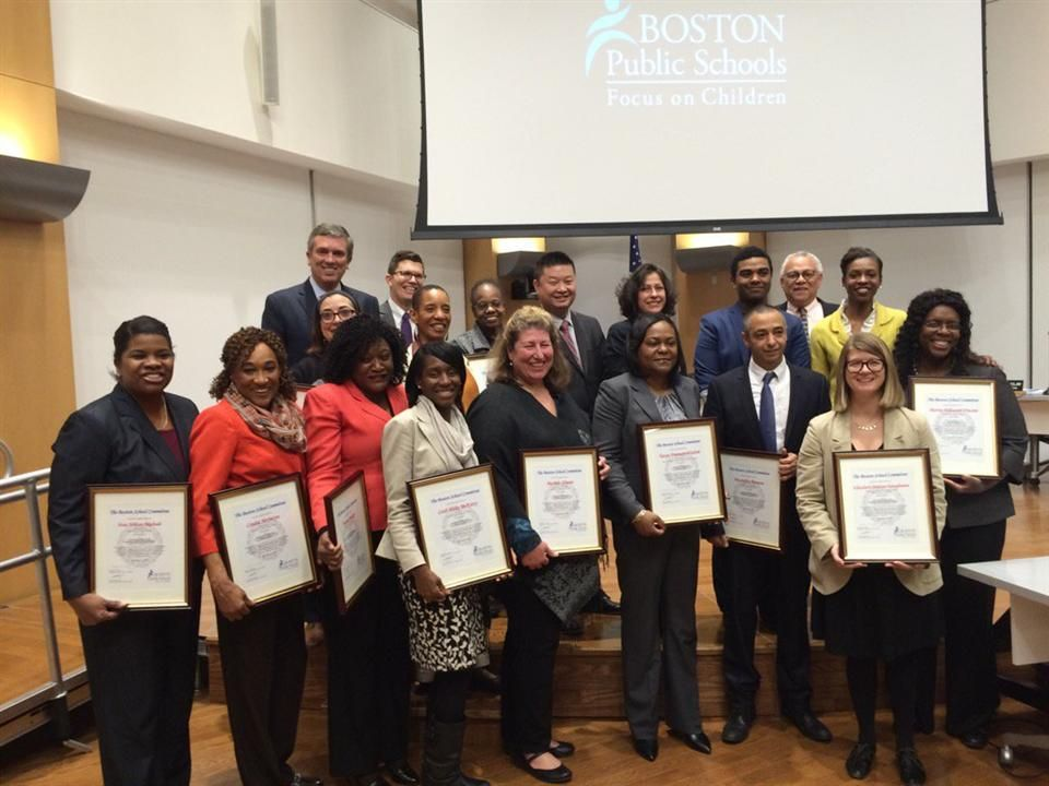 The Boston School Committee recently honored 13 Boston Public Schools employees who earned Doctorate